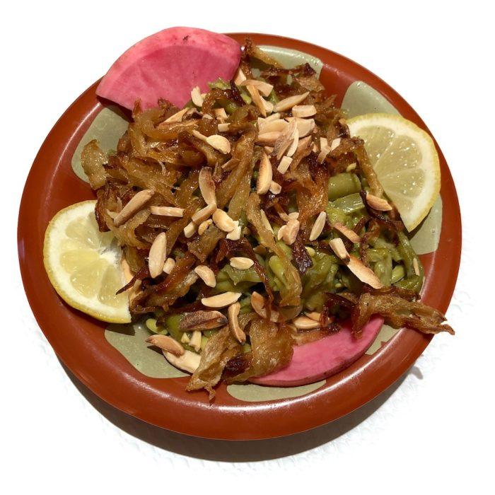 Loubieh, haricots verts assaisonnés d'ail et citron